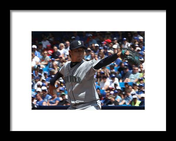 Hisashi Iwakuma Framed Print featuring the photograph Seattle Mariners v Toronto Blue Jays by Tom Szczerbowski