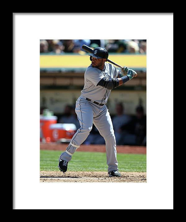 American League Baseball Framed Print featuring the photograph Seattle Mariners Vs. Oakland Athletics by Brad Mangin