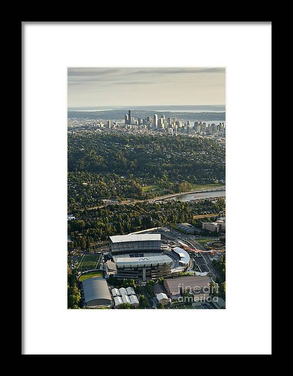 Elliott Bay Framed Print featuring the photograph Seattle Skyline With Aerial View Of The Newly Renovated Husky St by Jim Corwin