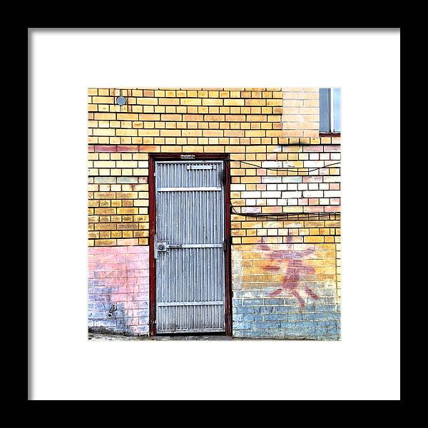 #door #brick Wall #graffiti Framed Print featuring the photograph Security Gate by Julie Gebhardt
