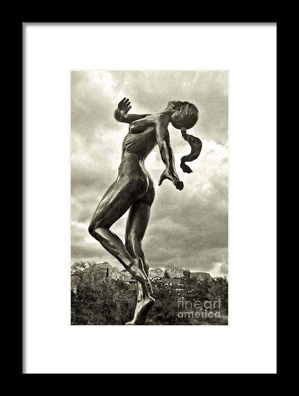 Sedona Arizona Framed Print featuring the photograph Sedona Arizona Statue In Sepia by Gregory Dyer