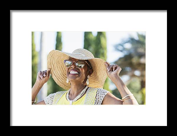 People Framed Print featuring the photograph Senior African-American woman wearing sunglasses by Kali9