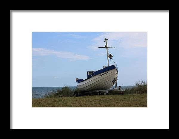 Serenity Framed Print featuring the photograph Serenity Boat by Emma Roper