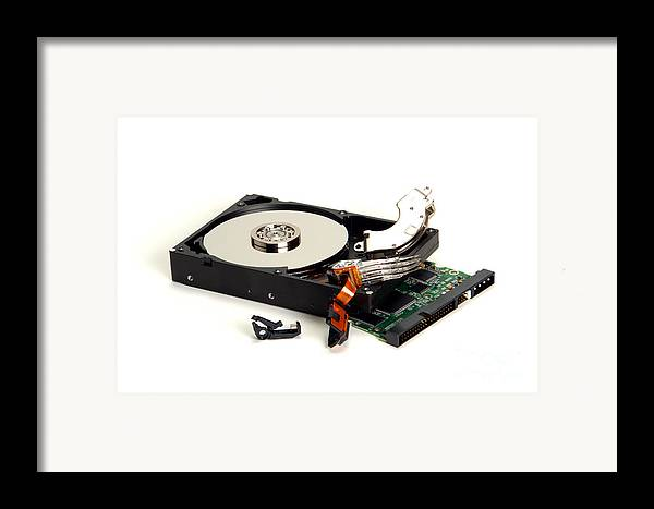 Hard Framed Print featuring the photograph Seriously Crashed Hard Drive by Olivier Le Queinec