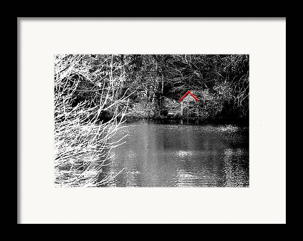 Black Framed Print featuring the photograph Shed On The Lake by Christopher Rowlands