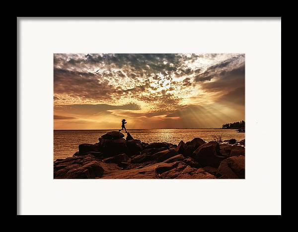 shine On Me chasing Light child In Landscape Children Light Silhouette lake Superior north Shore brighton Beach rock Scrambling Sunset sun Rays Rays Girl capture Minnesota greeting Cards mary Amerman Framed Print featuring the photograph Shine On Me by Mary Amerman