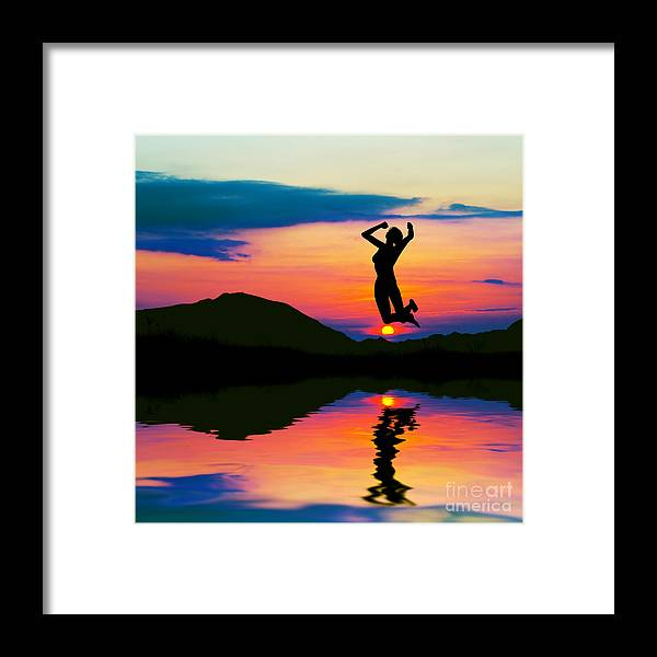 Silhouette Of Happy Woman Jumping At Sunset Framed Print By Michal Bednarek