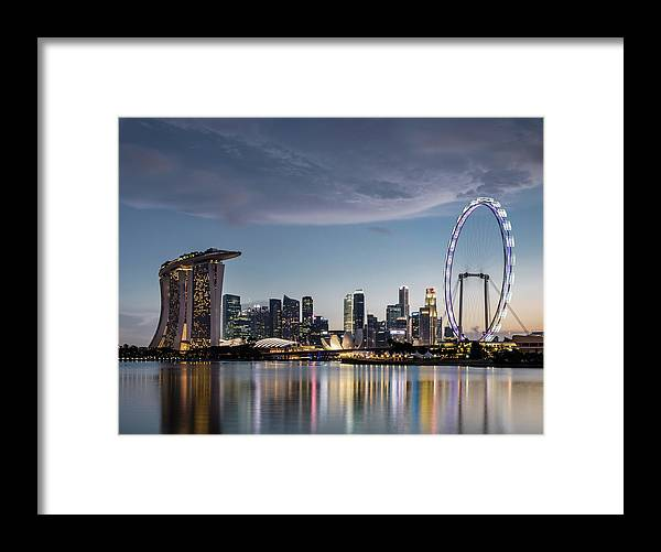 Built Structure Framed Print featuring the photograph Singapore Skyline At Dusk by Martin Puddy