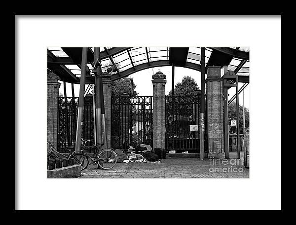 Sleeping At The Train Stop Framed Print featuring the photograph Sleeping At The Train Stop Mono by John Rizzuto