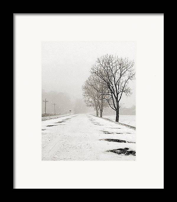 Black And White Photography Framed Print featuring the photograph Slow Going II by Julie Dant