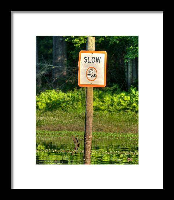 Signs Framed Print featuring the photograph Slow No Wake by Todd Bennett