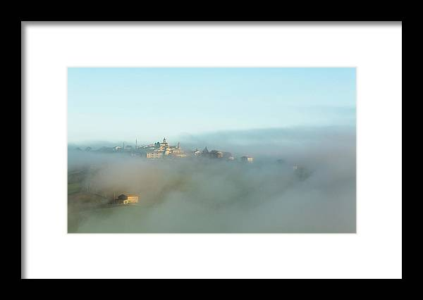 Scenics Framed Print featuring the photograph Small Italian Village In The Fog by Deimagine