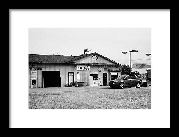 Small Framed Print featuring the photograph small roadside esso service gas station leader Saskatchewan Canada by Joe Fox