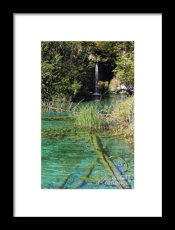 Nature Framed Print featuring the photograph Small Waterfall And An Emerald Colored Lake by Kiril Stanchev
