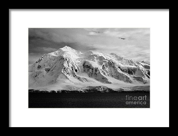 Snow Framed Print featuring the photograph snow covered landscape of anvers island mountain range and neumayer channel Antarctica by Joe Fox
