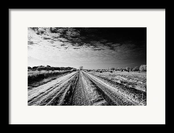 Small Framed Print featuring the photograph snow covered untreated rural small road in Forget Saskatchewan Canada by Joe Fox