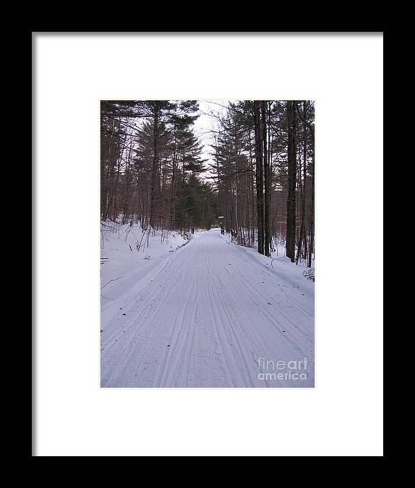 Snow Framed Print featuring the photograph Snowmobile Trail by Nancie Johnson
