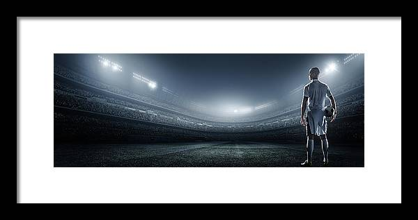Soccer Uniform Framed Print featuring the photograph Soccer Player With Ball In Stadium by Dmytro Aksonov