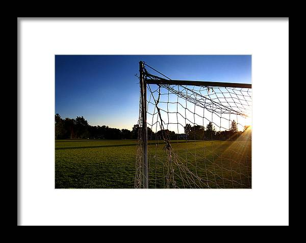 Soccer Framed Print featuring the photograph Soccer Sunset by Louise Kent