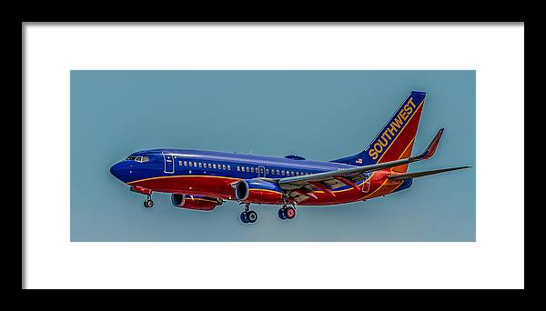 Plane Framed Print featuring the photograph Southwest 737 Landing by Paul Freidlund