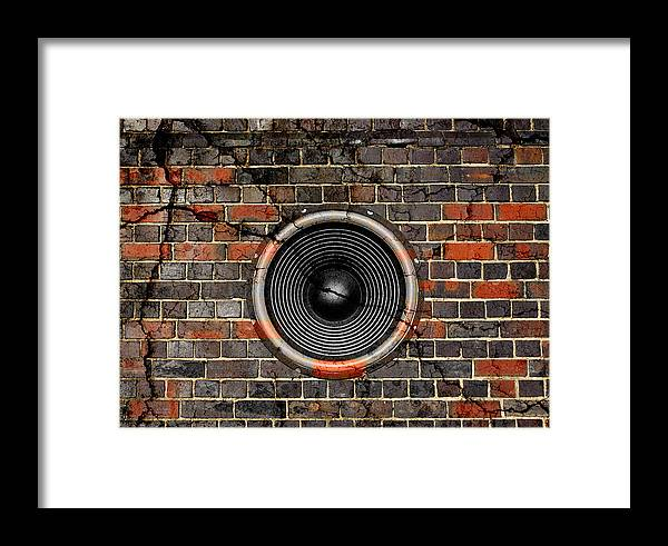 Background Framed Print featuring the photograph Speaker On A Cracked Brick Wall by Steve Ball