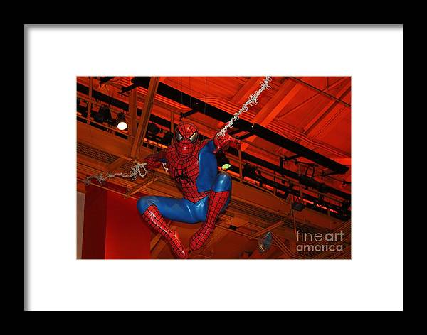 Spiderman Swinging Through The Air Framed Print featuring the photograph Spiderman Swinging Through The Air by John Telfer