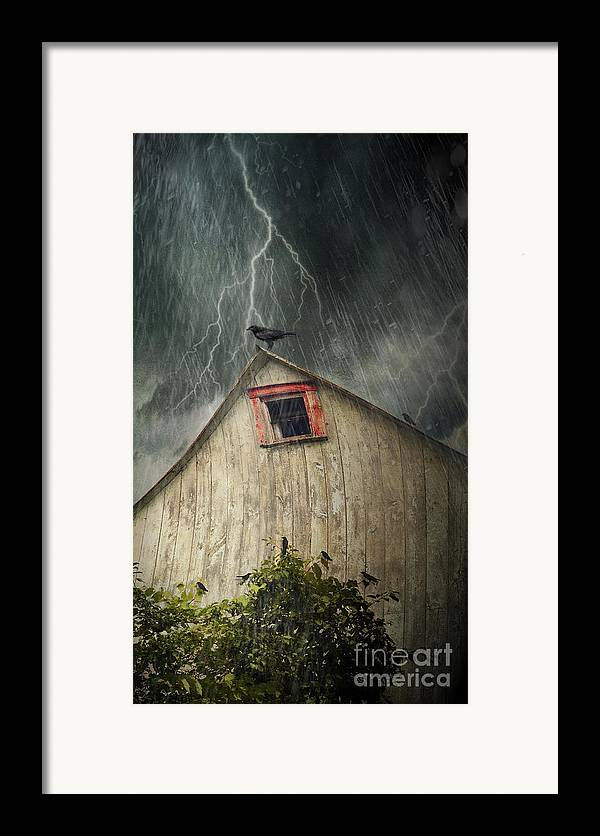 Abandoned Framed Print featuring the photograph Spooky Old Barn With Crows On A Stormy Night by Sandra Cunningham