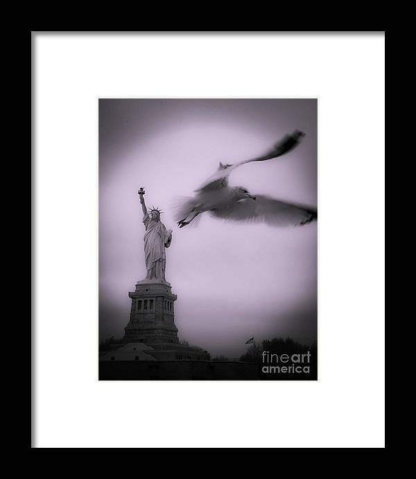 Statue Of Liberty Framed Print featuring the photograph Statue And Seagull by Alex Tuzinsky