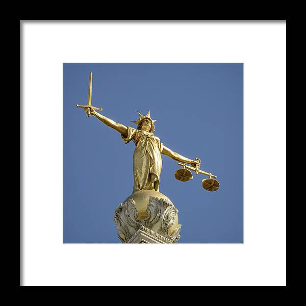 Punishment Framed Print featuring the photograph Statue of Lady Justice by Georgeclerk