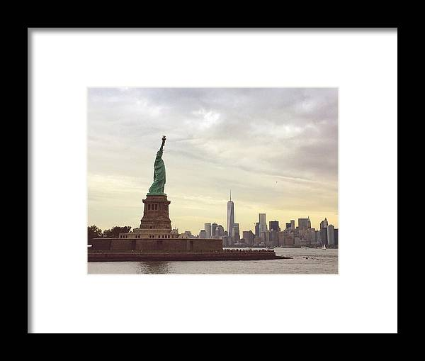 Art Framed Print featuring the photograph Statue Of Liberty With Manhattan by Christian Irizarry / Eyeem