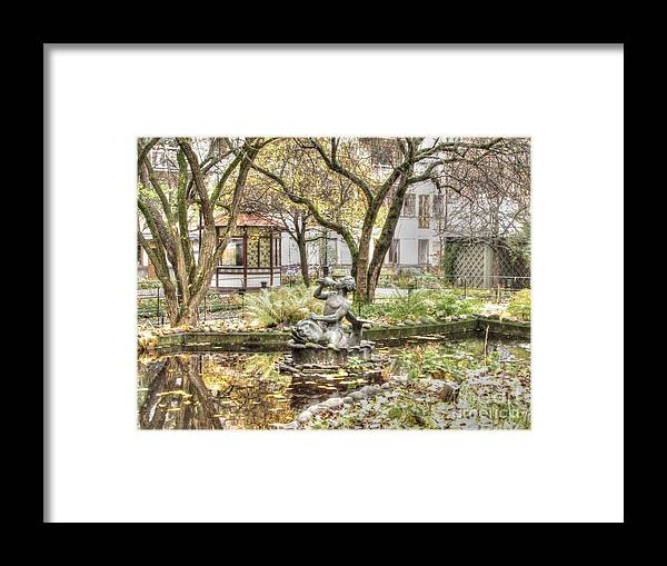 Stokholm Swiss Framed Print featuring the pyrography Stokholm Swiss In The Courtyard by Yury Bashkin