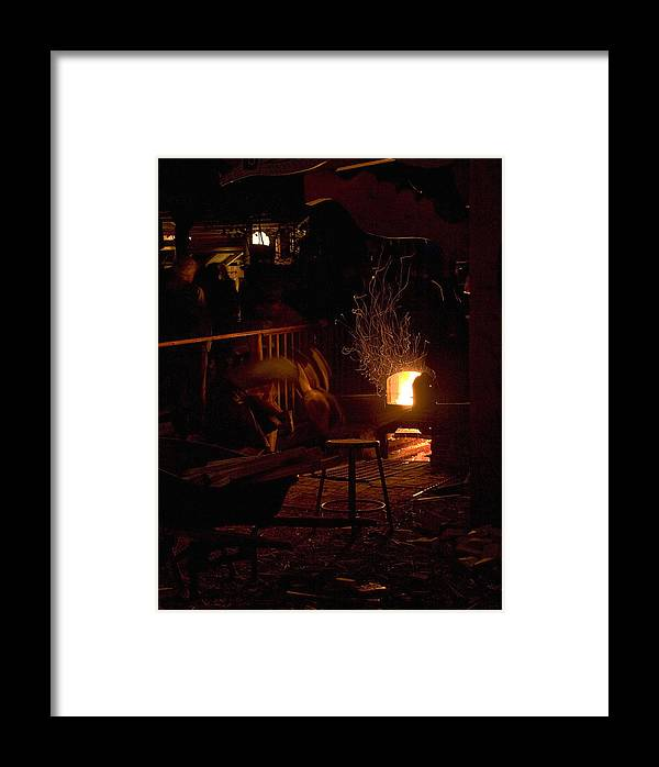 2011 Framed Print featuring the photograph Stoking The Sauna by John Higby