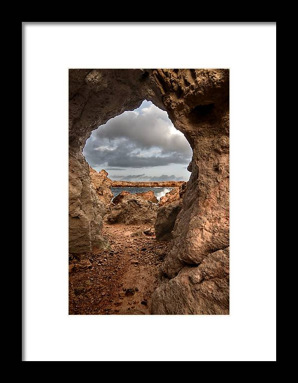Alley Framed Print featuring the photograph A Natural Stone Arch In North Coast Of Minorca Appears Like A Pass To One Thousand And One Night by Pedro Cardona Llambias