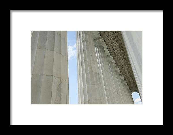 Stone Framed Print featuring the photograph Stone Pillars With Blue Sky by Brandon Bourdages