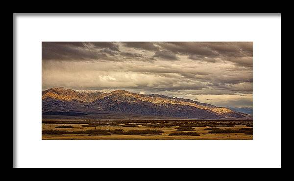 Death Valley Framed Print featuring the photograph Storm Clouds Over Snowy Peaks #2 by Stuart Litoff