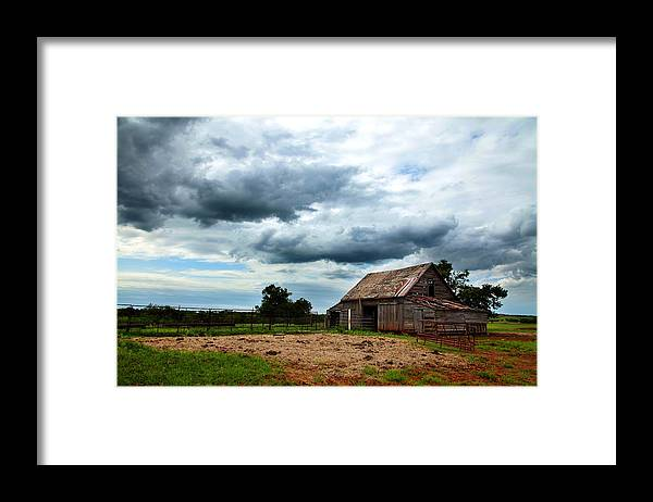 Barn Framed Print featuring the photograph Storms loom over Barn on the Prairie by Toni Hopper