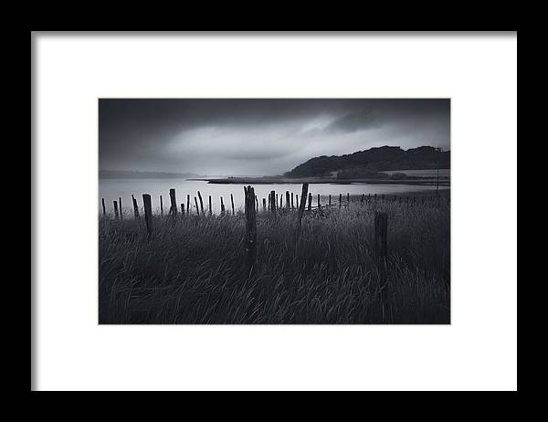 Wind Framed Print featuring the photograph Stormy weather over an Estuary in Brittany, France by Kristian Bell