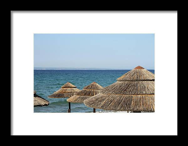 Straw Hat Framed Print featuring the photograph Straw Parasols by Suzyco