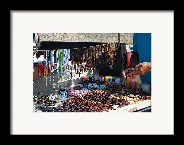 Artisian Framed Print featuring the photograph Street Vendor Selling Rosaries by Amy Cicconi