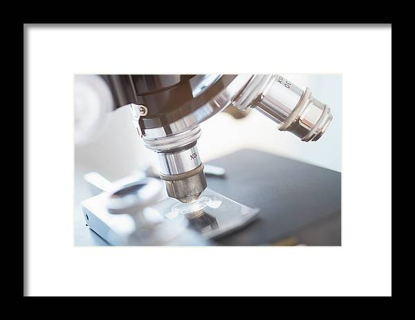 Microscope Framed Print featuring the photograph Studio Shot Of Microscope, Close-up by Tetra Images