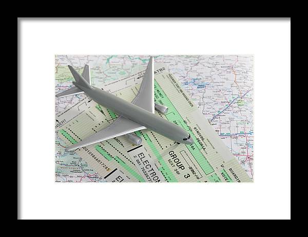 Airplane Framed Print featuring the photograph Studio Shot Of Toy Airplane With by Vstock Llc