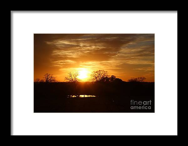 Sunsets Framed Print featuring the photograph Sun Setting Over The Pond by Kathy White
