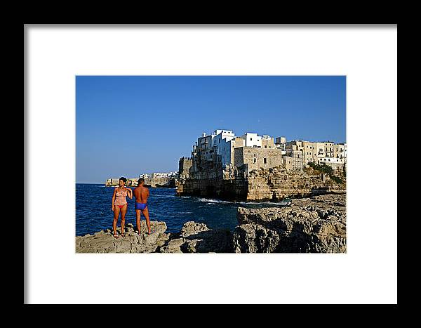 Polignano A Mare Framed Print featuring the photograph Sunbathing At Polignano A Mare by Gianmarco Cicuzza
