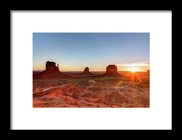 Tranquility Framed Print featuring the photograph Sunrise On Monument Valley by Loic Lagarde