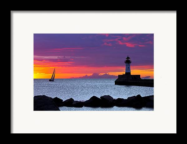 Sunrise lake Superior Sailing canal Park Lighthouse Duluth north Shore canal Park Lighthouse sail Boat Dawn Morning Magic Wow! Framed Print featuring the photograph Sunrise Sailing by Mary Amerman