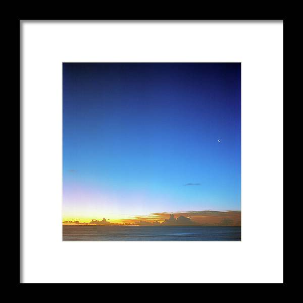 Tranquility Framed Print featuring the photograph Sunset And Moon At Uluwatu by Vsevolod Vlasenko