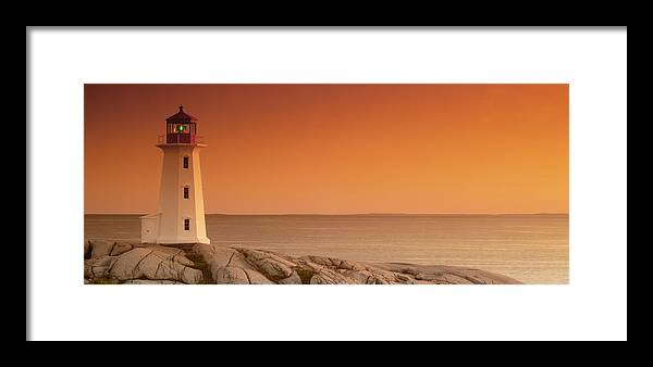 Atlantic Framed Print featuring the photograph Sunset At Peggy's Cove Lighthouse by Norman Pogson