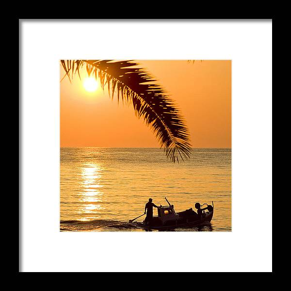Backgrounds Framed Print featuring the photograph Sunset boat at sea and palm tree by Raimond Klavins