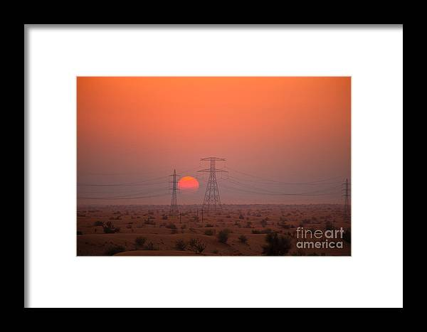 Cable Framed Print featuring the photograph Sunset On Pylons In Dubai Desert by Fototrav Print