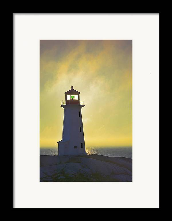 Beacons Framed Print featuring the photograph Sunset Over Peggys Cove Lighthouse by Thomas Kitchin & Victoria Hurst